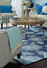 blue area rug and beige furniture