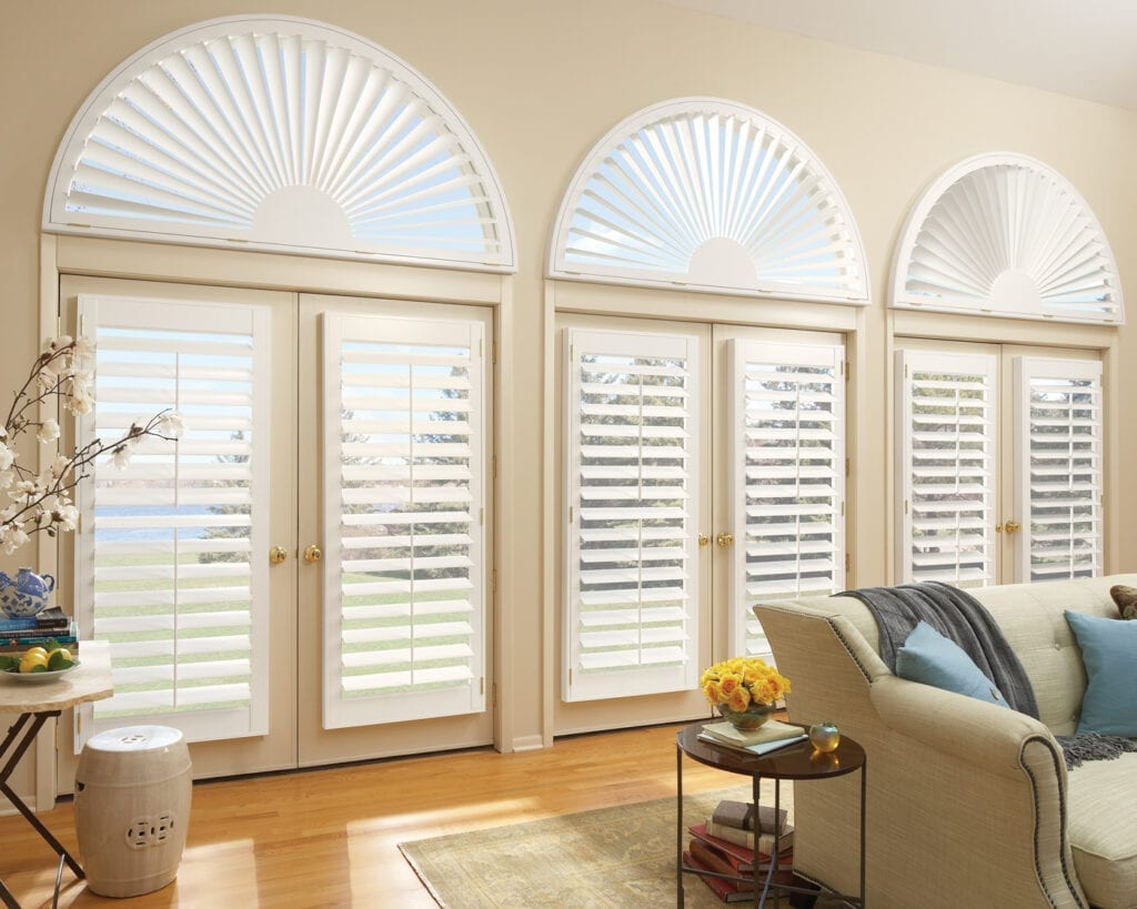 Heritance® Plantation Shutters with arch shutters above